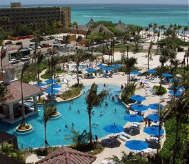 Marriott S Aruba Surf Club Opens On Palm Beach With Two And Three Bedroom Villas Amenities Like Large Pools Connected By A Winding Lazy River