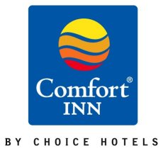 The New Comfort Inn Sign Featuring Brand S Signature Multi Colored Circular Sunburst On A Royal Blue Background Will Be In Place Domestic