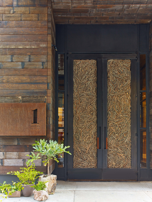 Doors made of 16,000 fallen twigs welcome guests to 1 Hotel Central Park. Photo Credit Eric Laignel