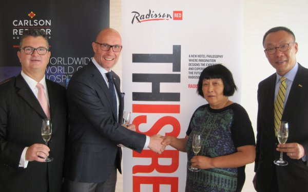 Thorsten Kirschke, president, Carlson Rezidor Hotel Group, Asia Pacific    with Mdm Lv Li Hua, of Shenyang New Times Investment Co., Ltd signs the first Radisson Red in Shenyang